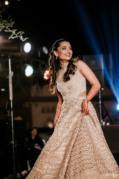 a candid capture of the bride dancing at her sangeet