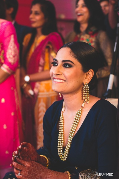 Crushing over her dark eyemakeup and bold polki necklace for the sangeet ceremony held at Le Meridien, Gurgaon.