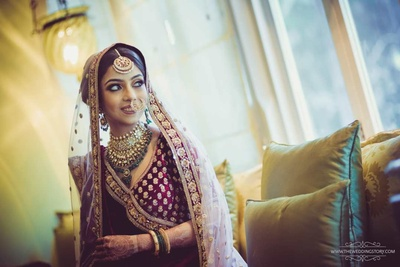 Candid bridal photo of Krutika as she gets ready for the wedding