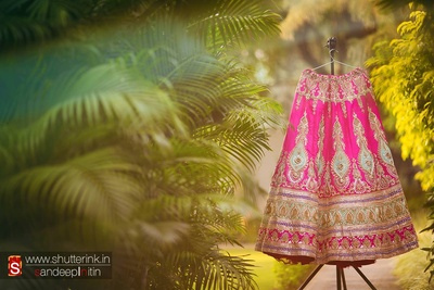 Pink wedding lehenga embellished with aqua embroidered motifs, sequins, beads, stones and thread work
