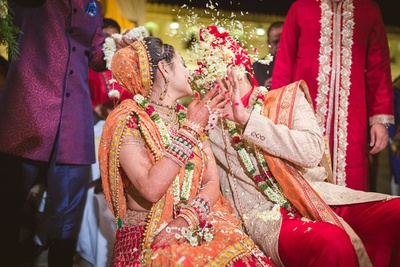 Flower petals being lavishly showered on the couple