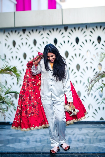 the bride posing with her lehenga before getting ready