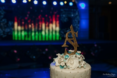 The couple's Sangeet cake featured their initials.