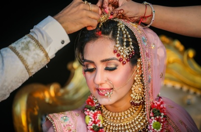 candid capture of the bride during the sindoor ceremony