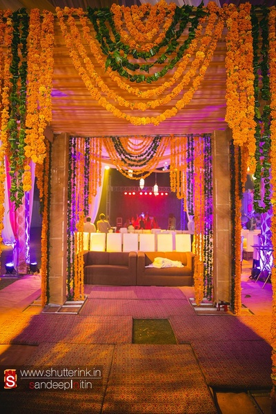Wedding venue decorated with Marigold strings arranged in ascending order