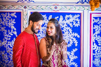 A candid picture of the bride and the groom at their mehendi ceremony