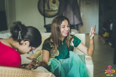 Candid picture of  the bride during her mehendi