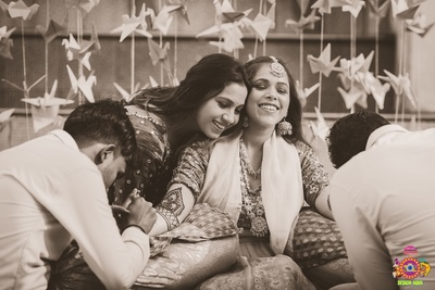 Candid shot of the bride at her mehendi ceremony