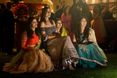 The bride sitting with her bridesmaids