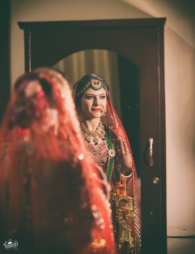 Bride's mirror shot captured tight before the wedding ceremony