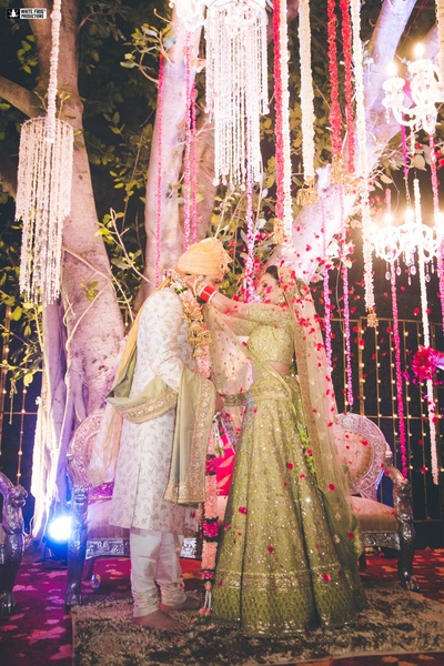 People shower flower petals on the couple at the varmala ceremony!