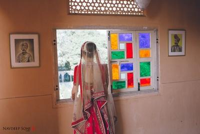 Red and off-white wedding lehenga by Sabyasachi Mukherjee