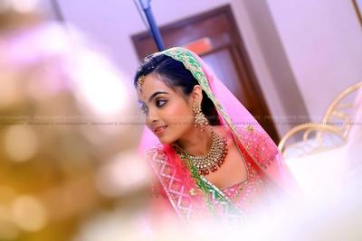 Rose blush and green bridal lehenga embellished with gota patti work, styled with kundan studded jewellery set