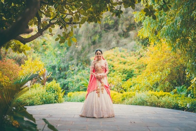 Ivory and peach lehenga worn by the bride for the hindu wedding ceremony at Aashyana Lakhanpal, Goa