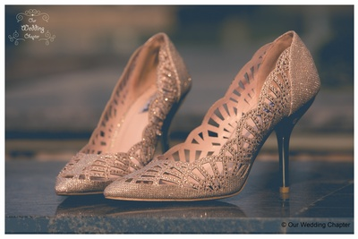 Glistening gold cut-out designed bridal shoes