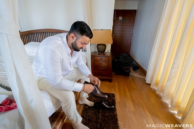 The groom getting ready for his wedding