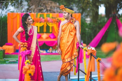 Bride and groom looking all colorful for their mehendi ceremony rituals held at Clarks exotica resort and spa, bangalore