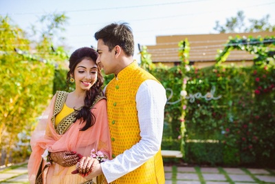Lovey dovey picture of the bride and groom at their mehendi