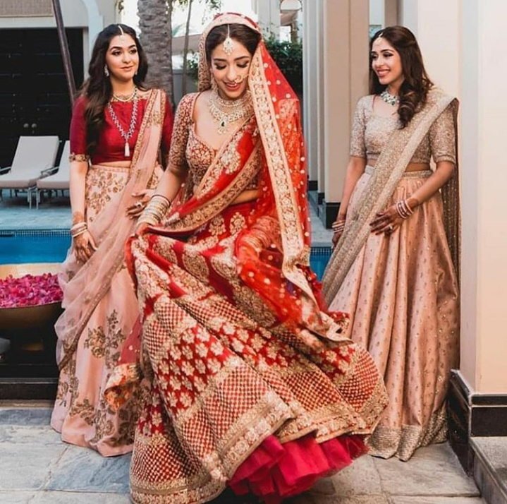 9. The sisters can't stop staring at this beautiful bride!