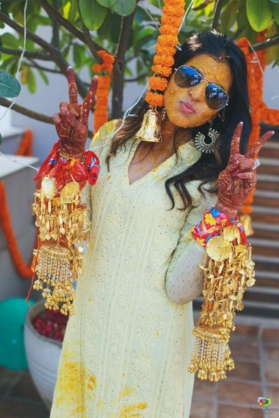 The bride posing at her haldi