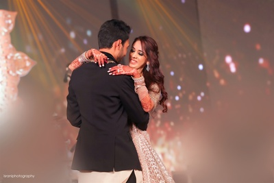 candid picture of the couple dancing at the sangeet