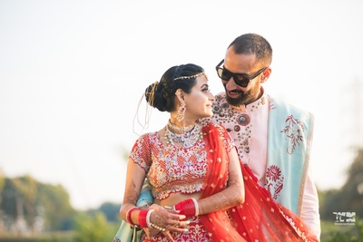 cute couple photography in their wedding ensembles post the wedding ceremony