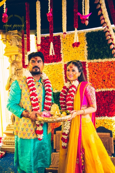 bride and groom in the haldi ceremony