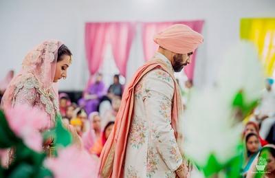 Bride and Groom taking saat pheras at the wedding ceremony