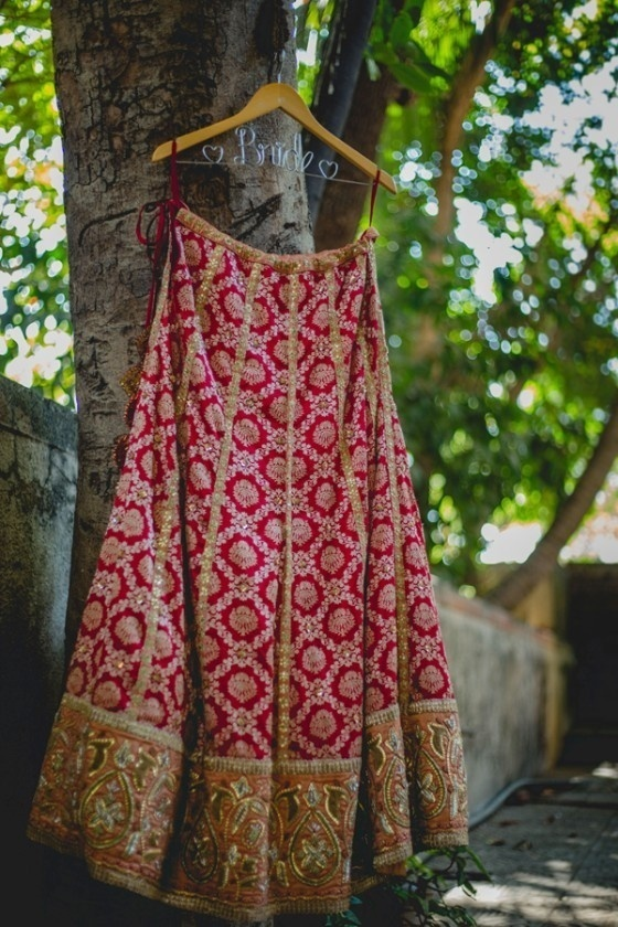11) Red lehenga with golden lines of sequins