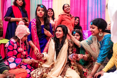 the bride surrounded by bridesmaids at the chuda ceremony