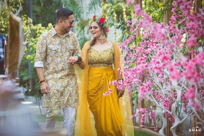 The bride and groom post their haldi ceremony