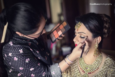Classy make up in red and gold with matching golden jewelery and lehenga