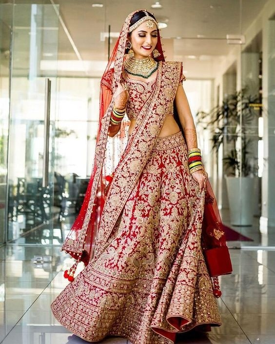 19f1a301a6 A classic red lehenga is the most dependable choice for your wedding wear.  You can literally never go wrong with it. This beautiful red bridal lehenga  2018 ...