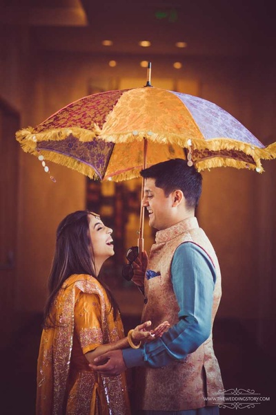 Bride and groom in a candid photo for their pre wedding captured by The Wedding Story