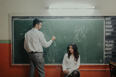 The bride tries to sketch his better half with chalk!