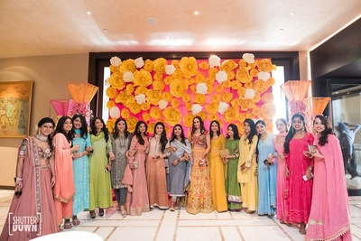 the bride with her bridesmaids at the mehendi ceremony