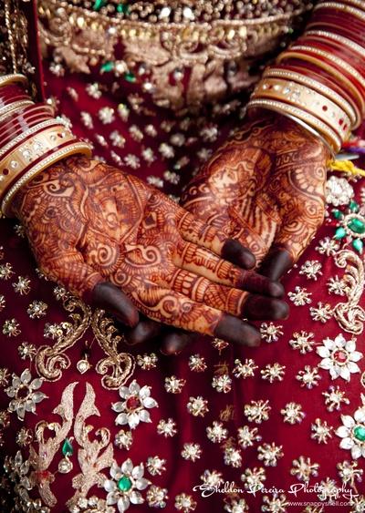 Red wedding lehenga decked in stone and zari work