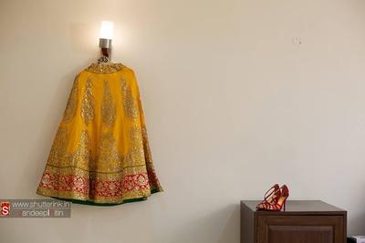 Canary wedding lehenga embellished with zari motifs and red cutwork border