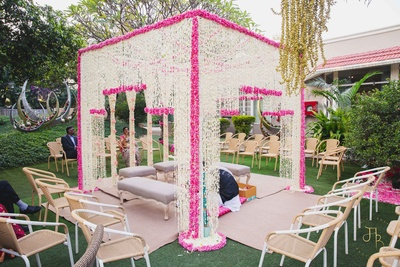 pink and white floral mandap decor giving it a classy look