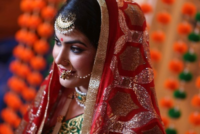 Hoop nose ring and gold meenakari maangtikka makes the bride beyond stunning