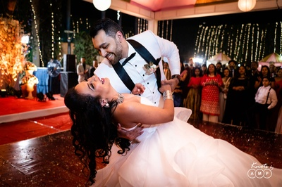 a candid capture of the bride and groom dancing at their reception