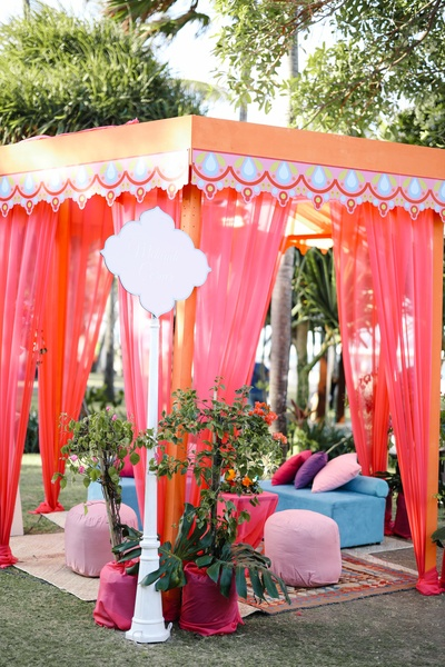 A cabana-like colourful seating arrangement.