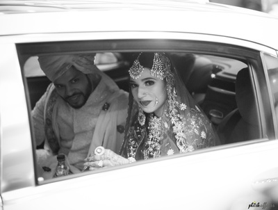 The bride and groom leaving the venue as part of the vidaai ceremony.