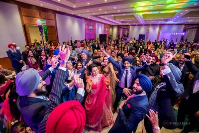 The couple and their families setting the dance floor on fire with their jhakaas moves!