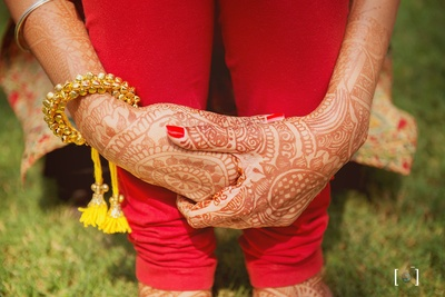 Hands filled with beautiful intricate mehendi design.