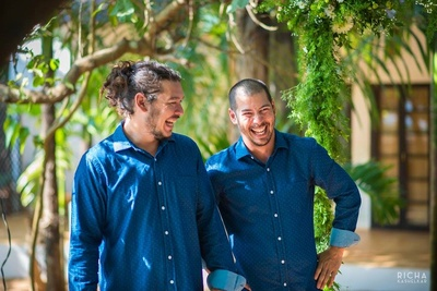 Bestman twinning the groom with matching navy blue shirt with white textures for the white and blue themed intimate wedding ceremony