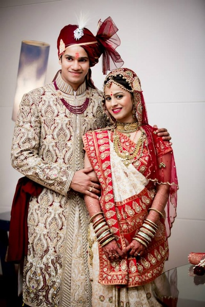 Bridal couple wearing traditional Indian wedding attire