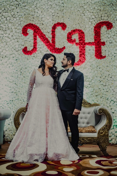 Heena wore a stunning pouffy white gown while Niraj looked dapper in a black tuxedo