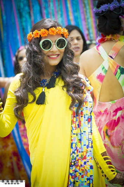 Abstract printed on sun shine yellow dress accessorized with funky glasses and sequenced orange flowers tiara