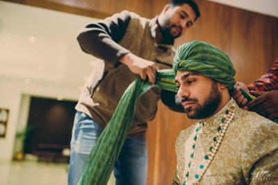 Traditional groom gets ready for his wedding